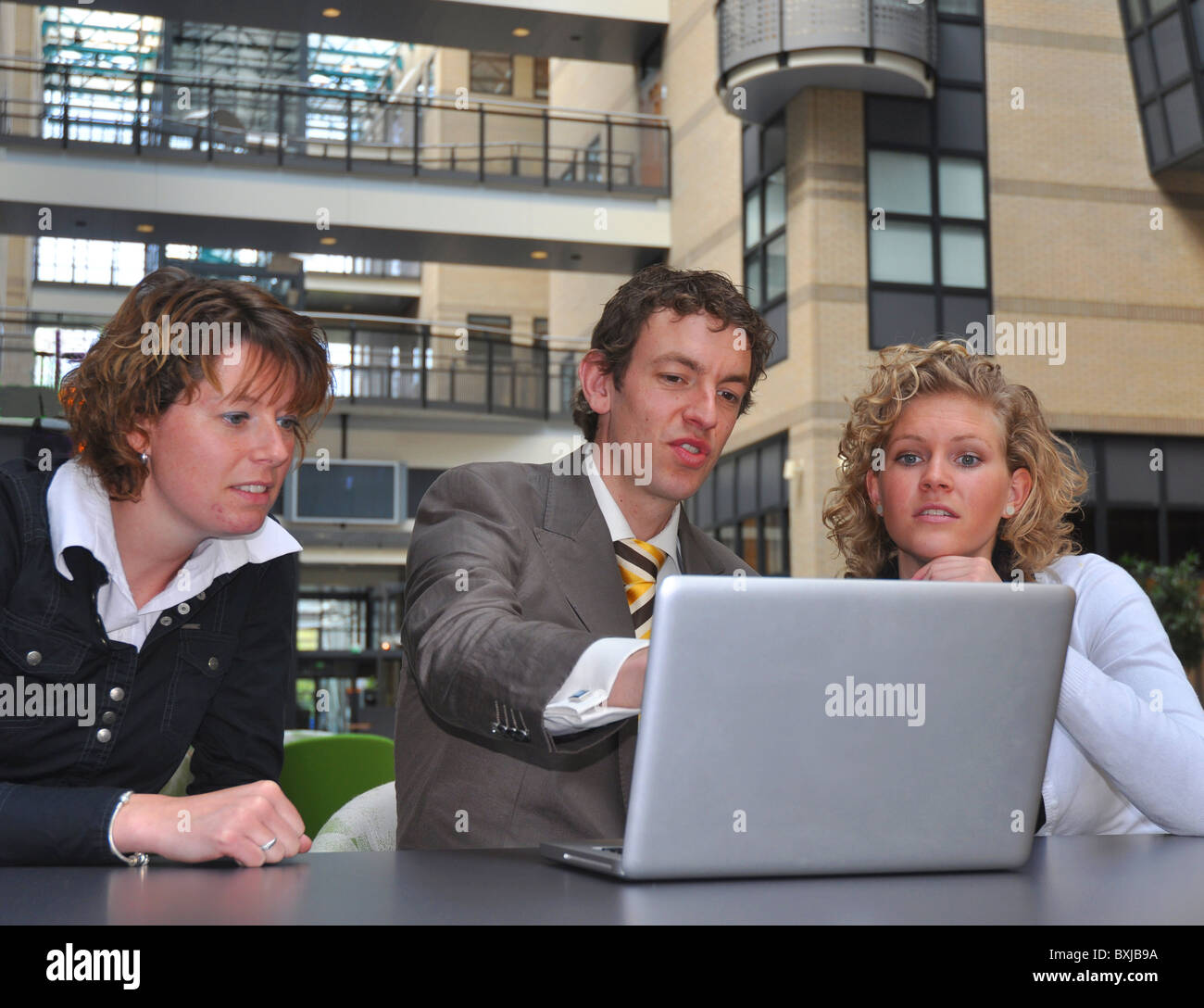 Business man and woman preparing for a job interview - Stock Image