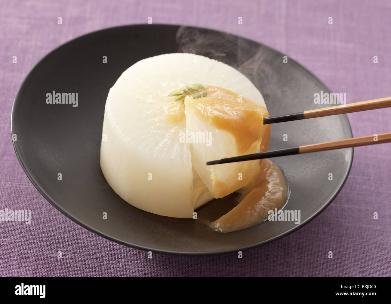 Simmered daikon radish with miso - Stock Image