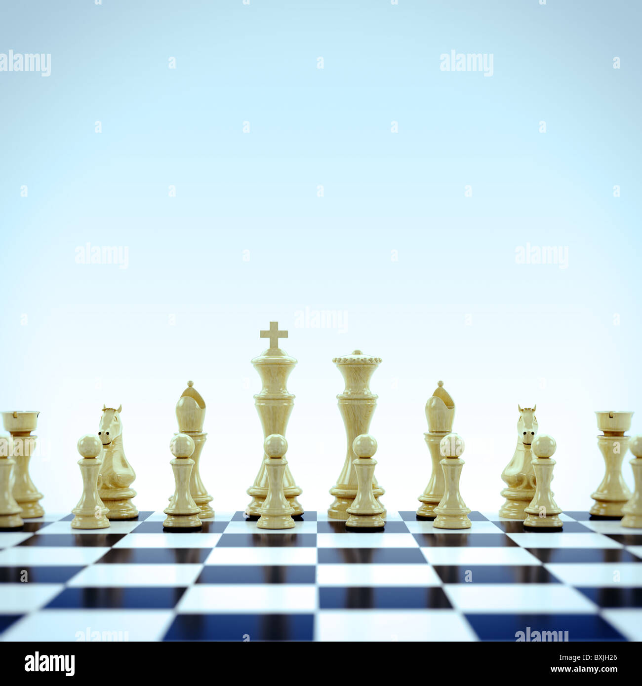 White chess pieces on chess board - Stock Image