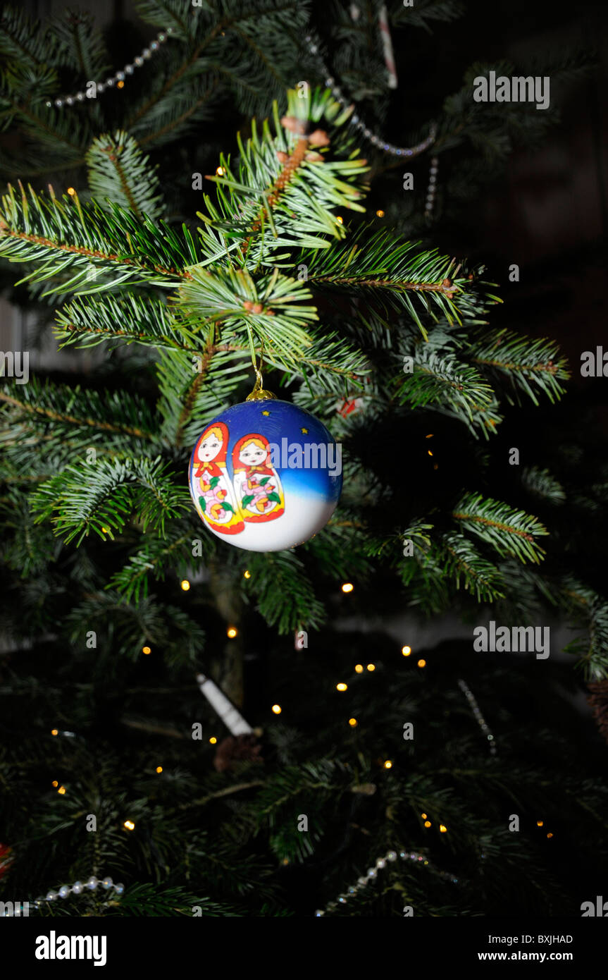 close up view of decorations hanging on christmas tree stock image