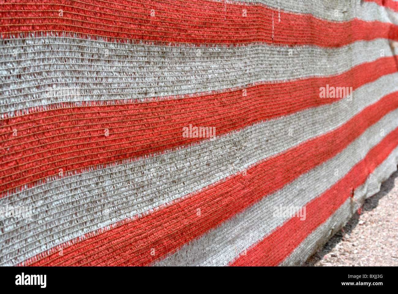 drop cloth red and white nylon used on construction sites Stock Photo