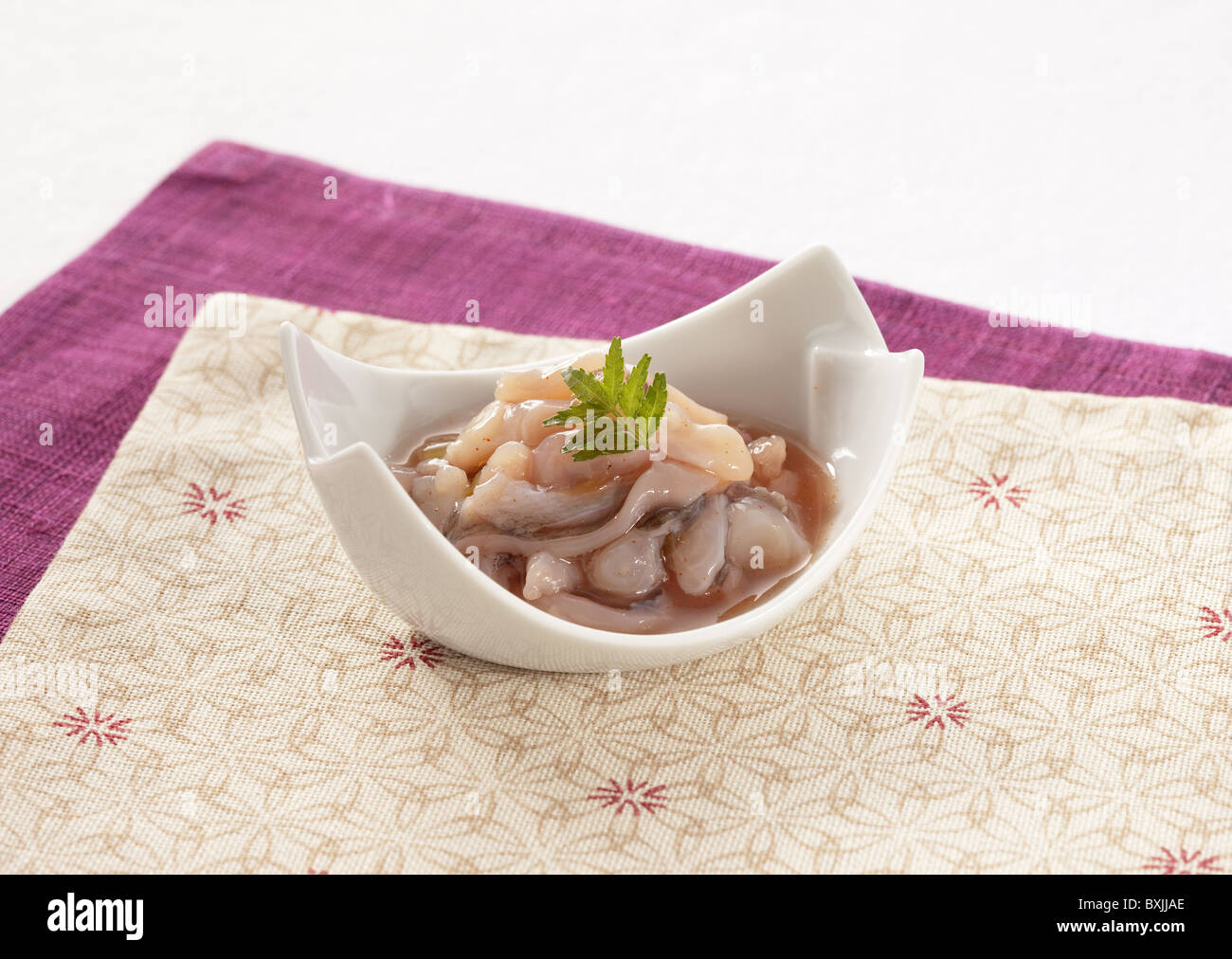 Fermented octopus flavored with wasabi - Stock Image