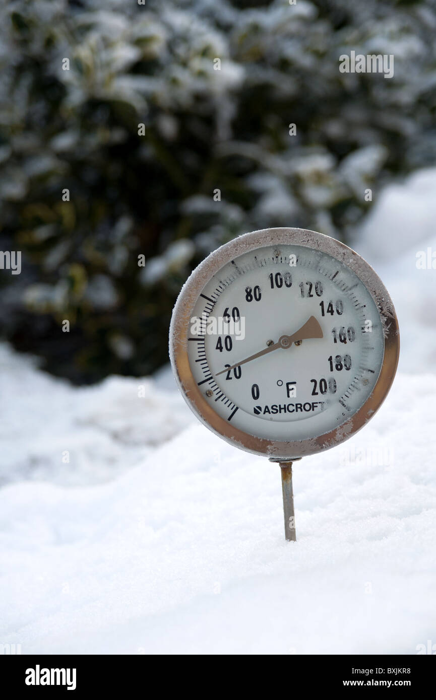 Thermometer Placed In Snow Showing The Ambient Air Temperature As 20 Degrees Fahrenheit Or Roughly Minus 6 Celsius