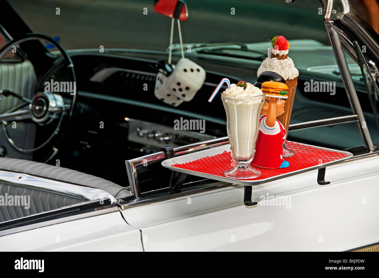 Fast food on hanging window tray at drive-in - Stock Image