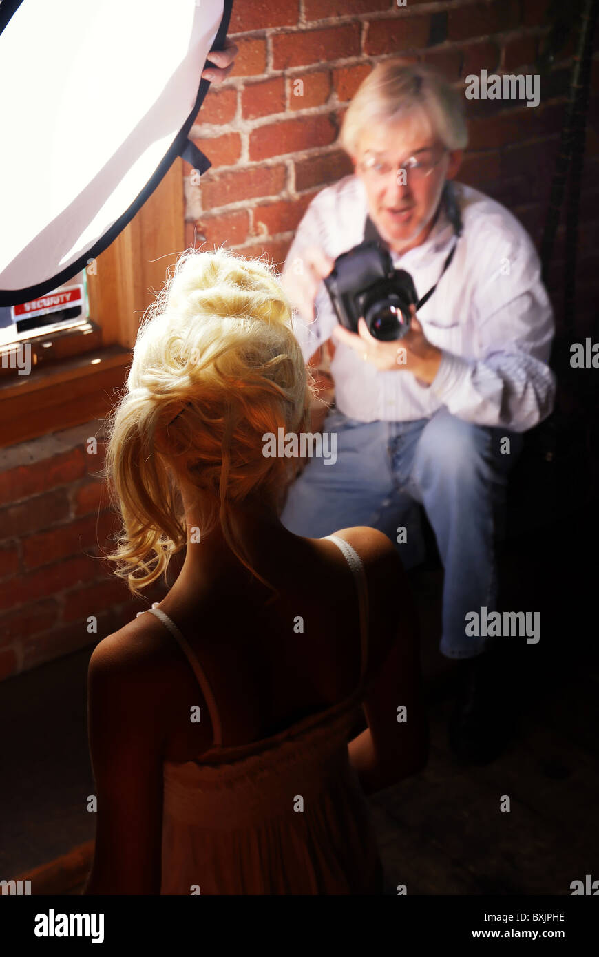 Blonde model poses in front of photographer, Sacramento Fashion Week, California Stock Photo