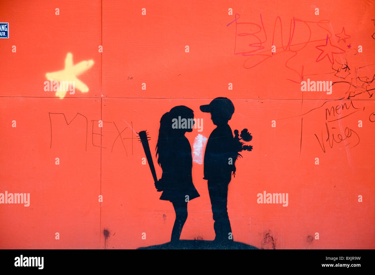 'Love and Hate' graffito mural on a builders hoarding, Amsterdam, Netherlands. - Stock Image