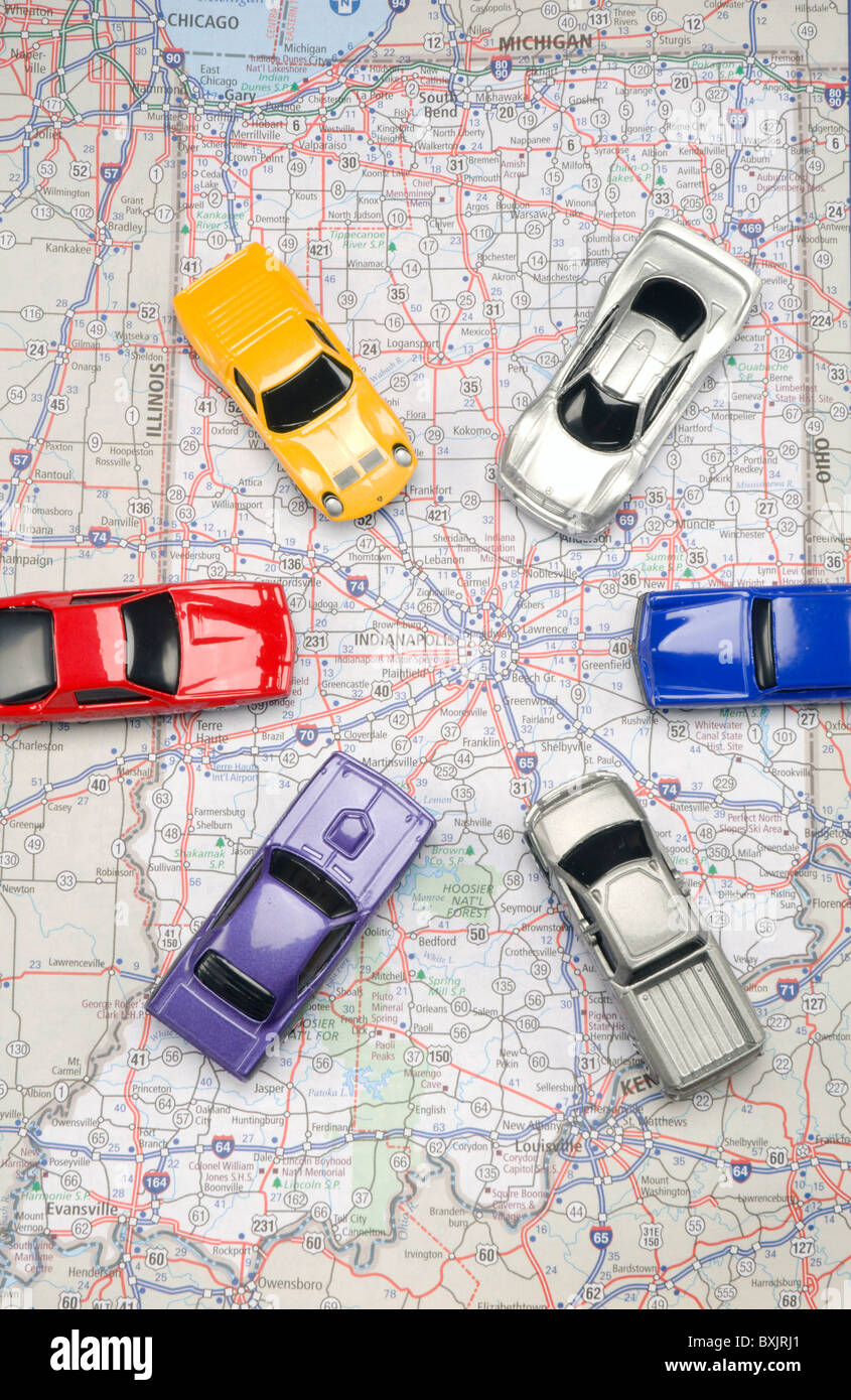 Cars driving across map - Stock Image