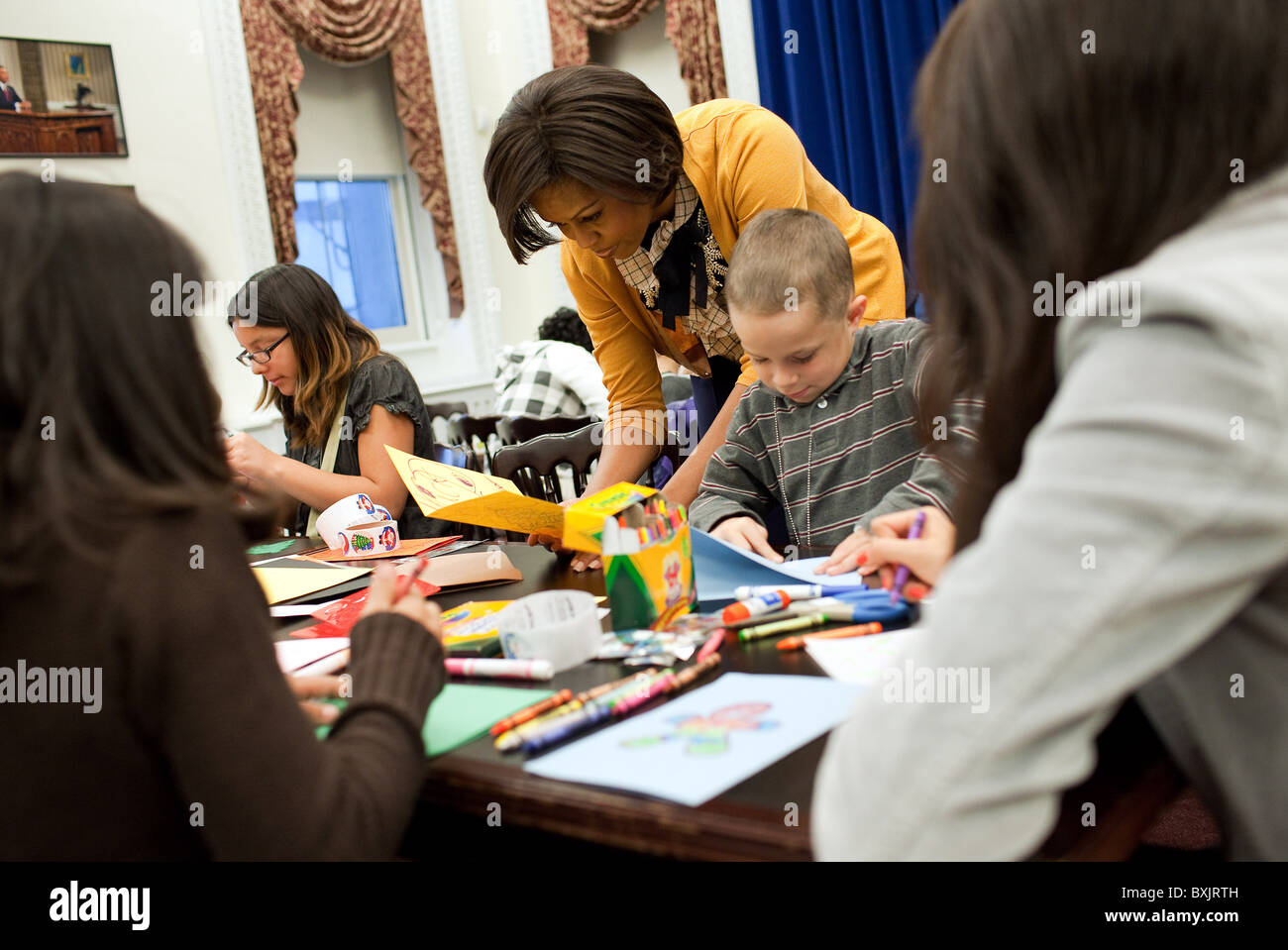 Michelle Obama with students making   for active duty service members. - Stock Image