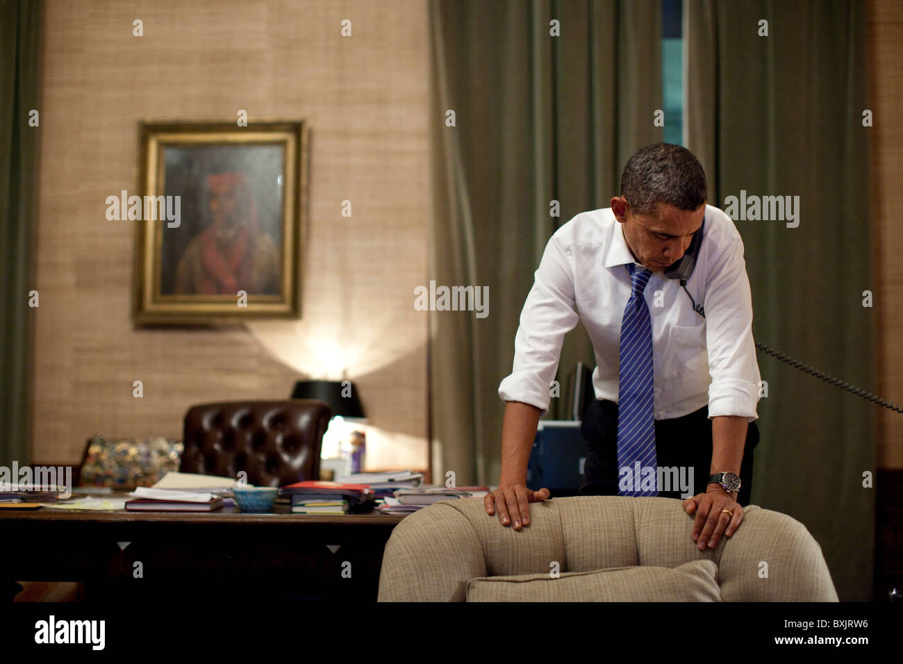 President Barack Obama talks on the phone - Stock Image