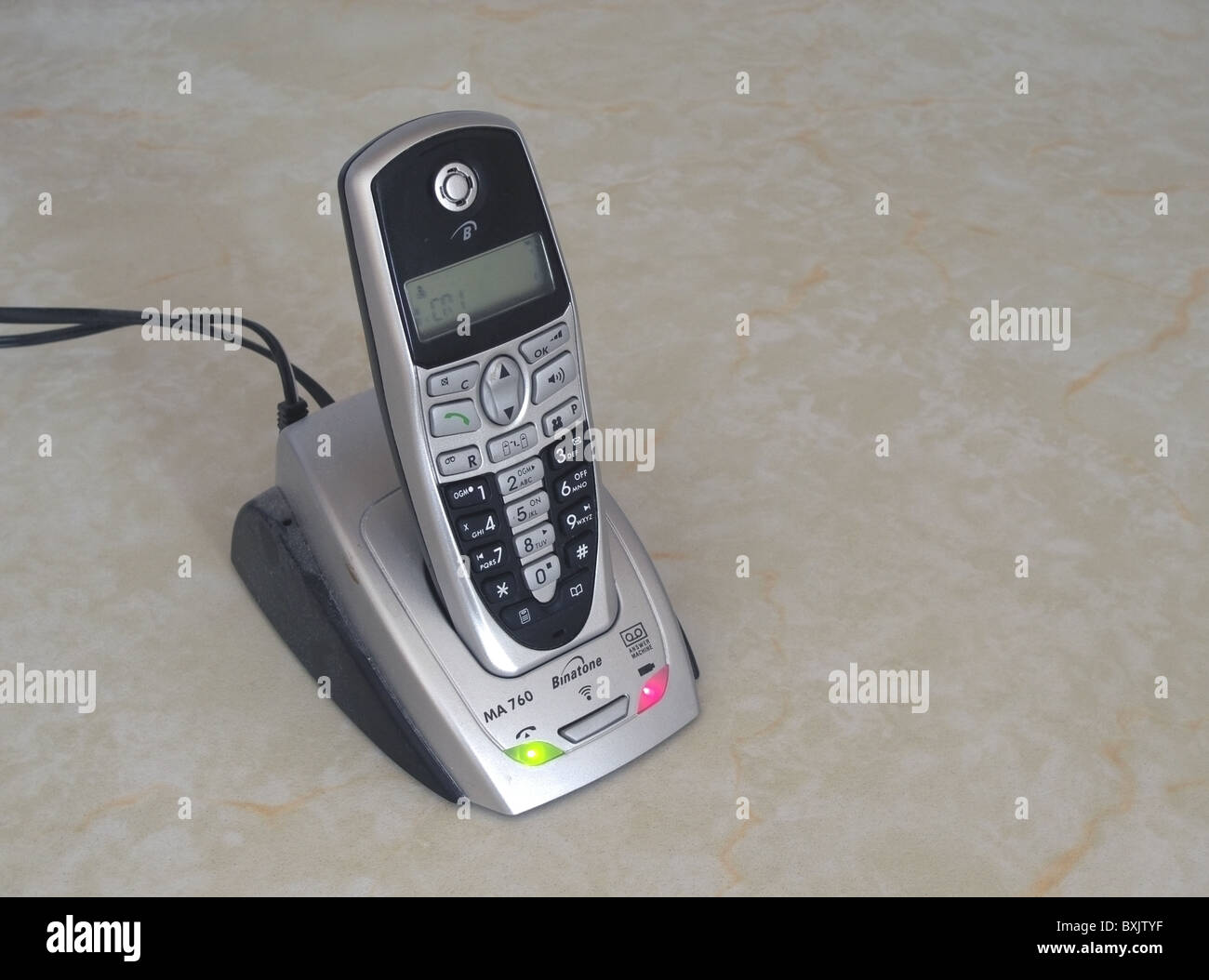Binatone Cordless Telephone Charging Up in it's Docking Station, UK - Stock Image