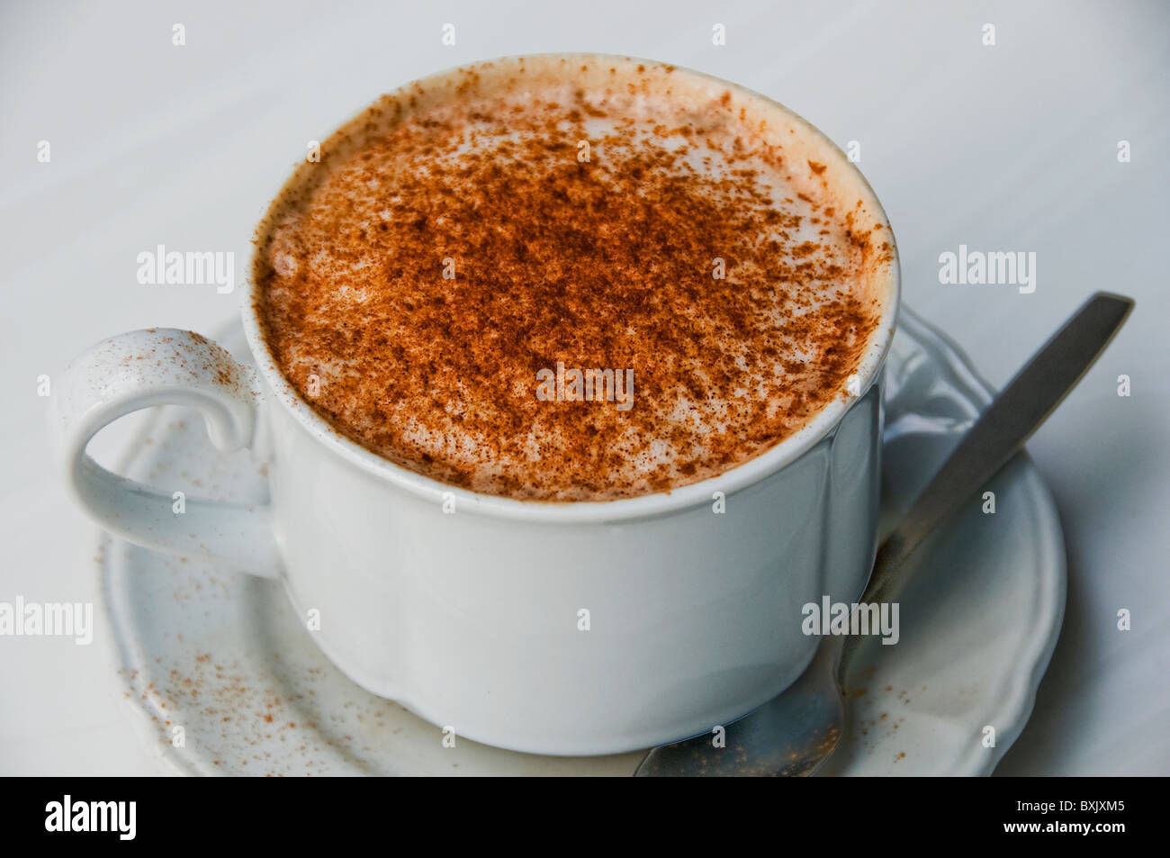 Café latte in cup on restaurant table Stock Photo