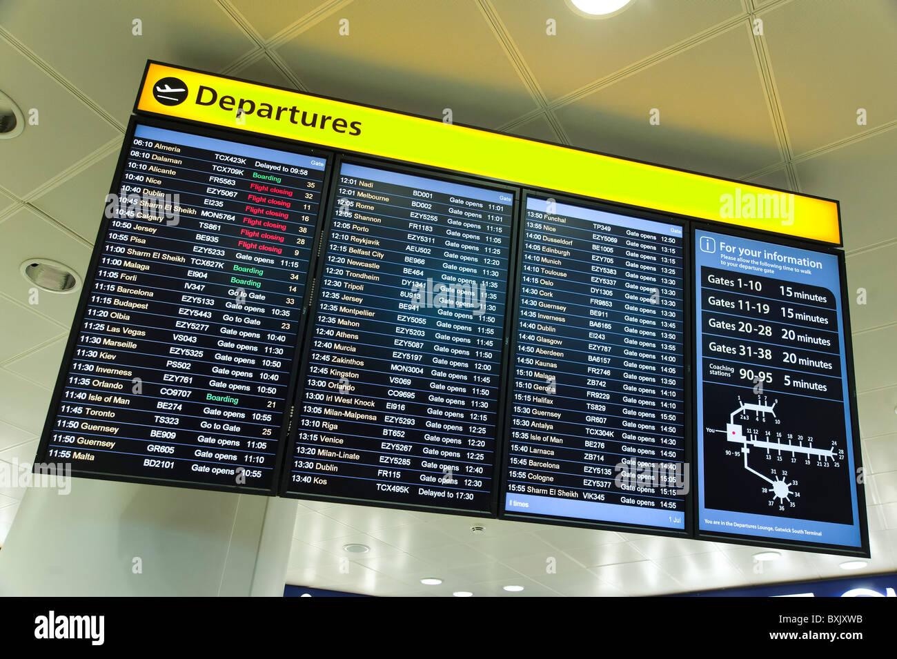 Airport departures board, England, UK - Stock Image