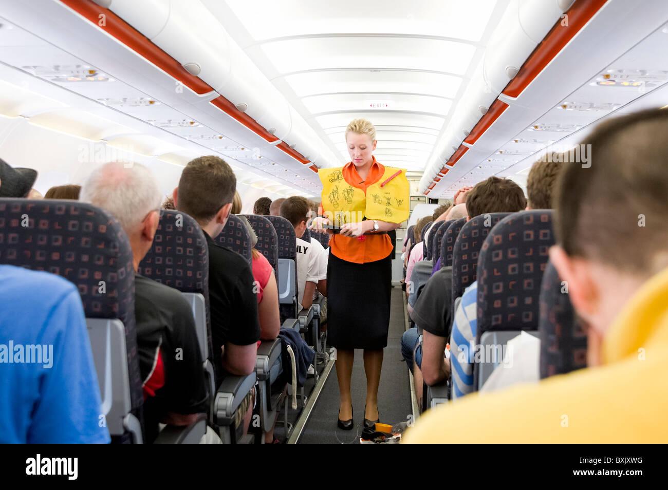 Preflight safety demonstration on board EasyJet plane, England, UK - Stock Image