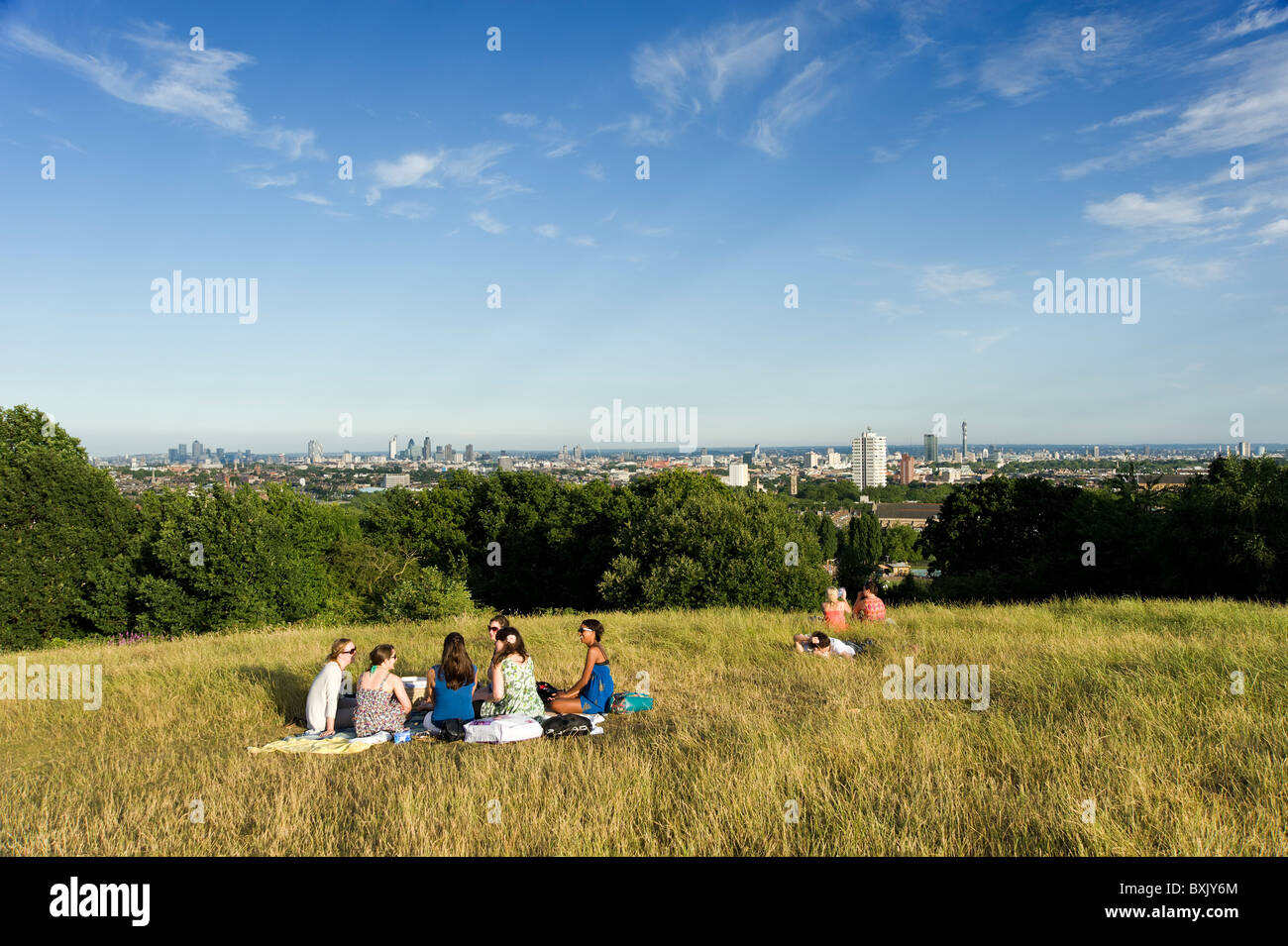 People at the top of Parliament Hill, Hampstead Heath, London, England, UK - Stock Image