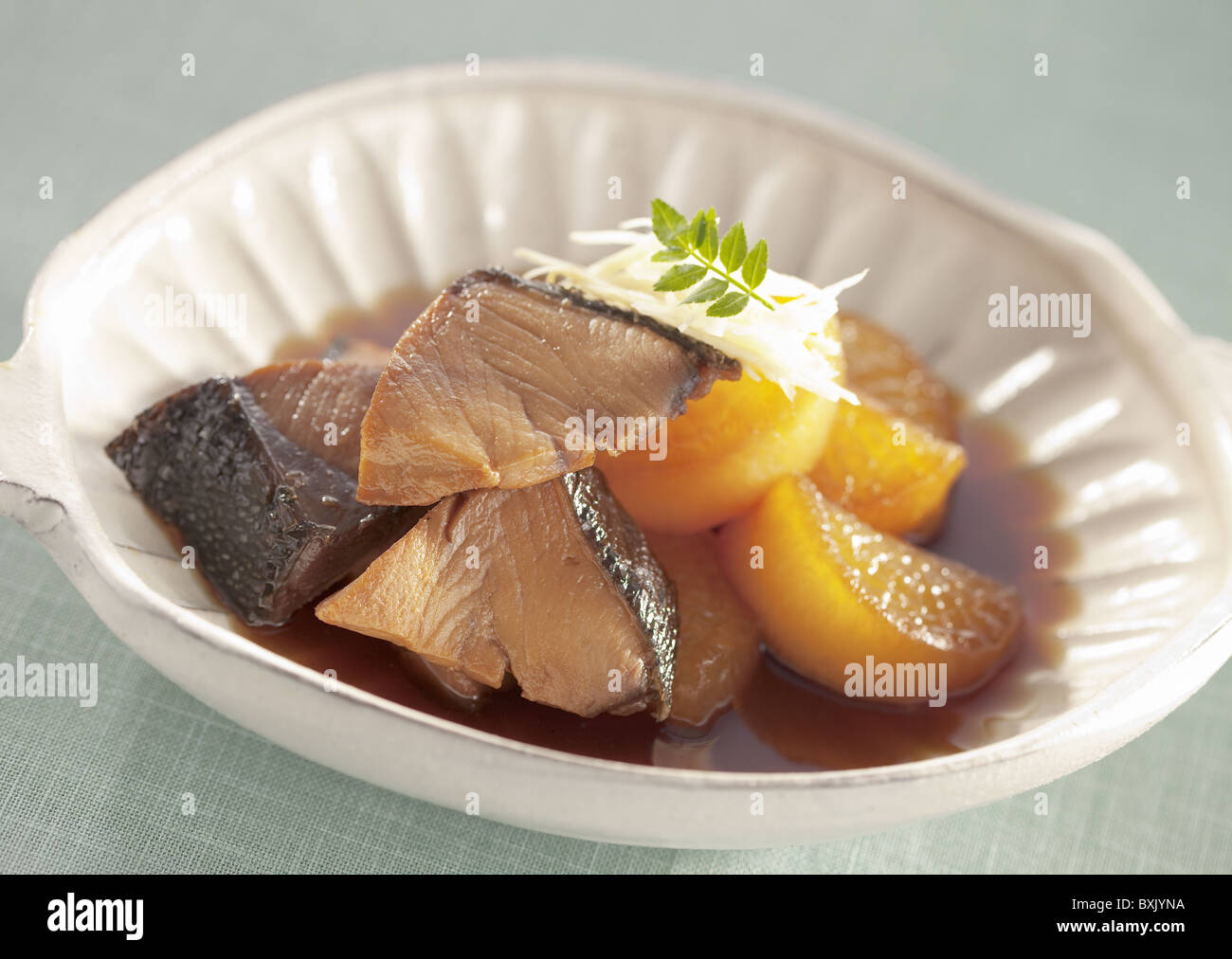 Yellowtail and Japanese radish simmered in soy sauce - Stock Image