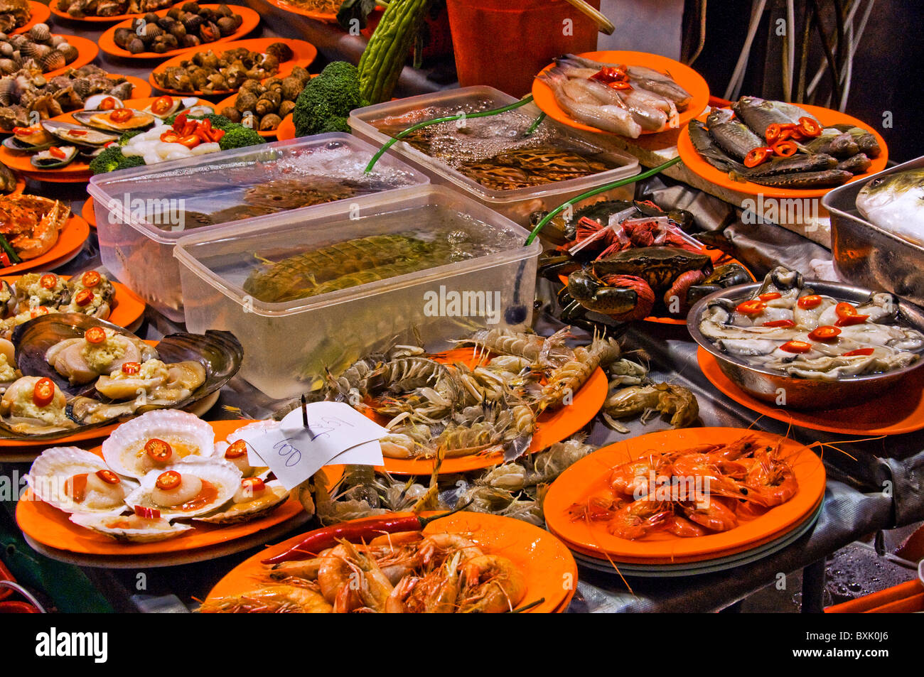 Unique weird plates of food on display at ourdoor restaurant in downtown Hong Kong China - Stock Image