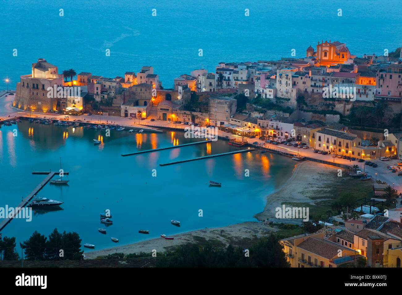 View over harbour at dusk, Castellammare del Golfo, Sicily, Italy - Stock Image