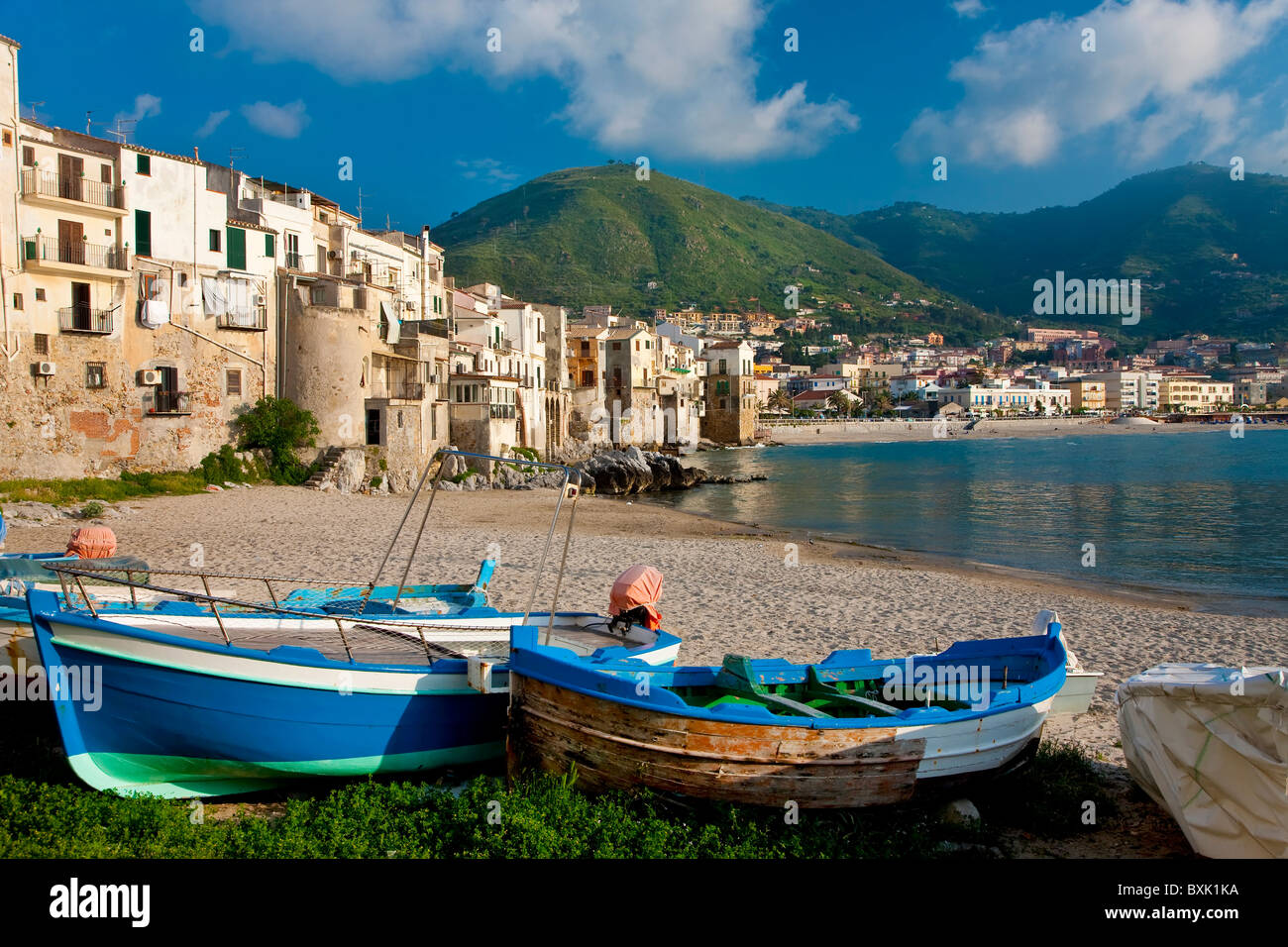 Boats on beach, Cefalu, North coast, Sicily Italy - Stock Image