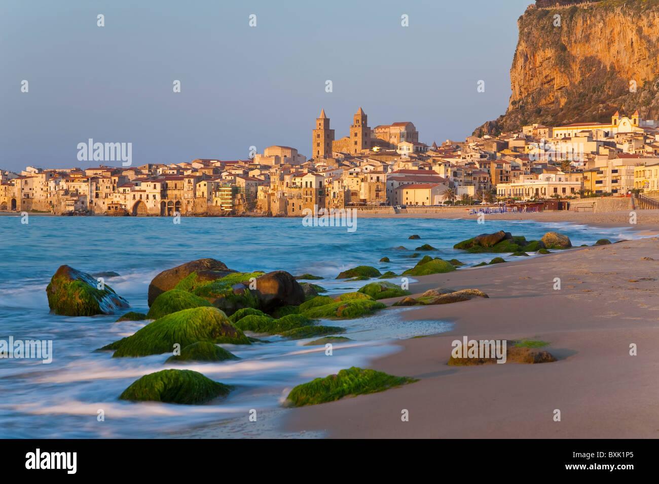 Beach at sunset, Cefalu, N coast, Sicily - Stock Image