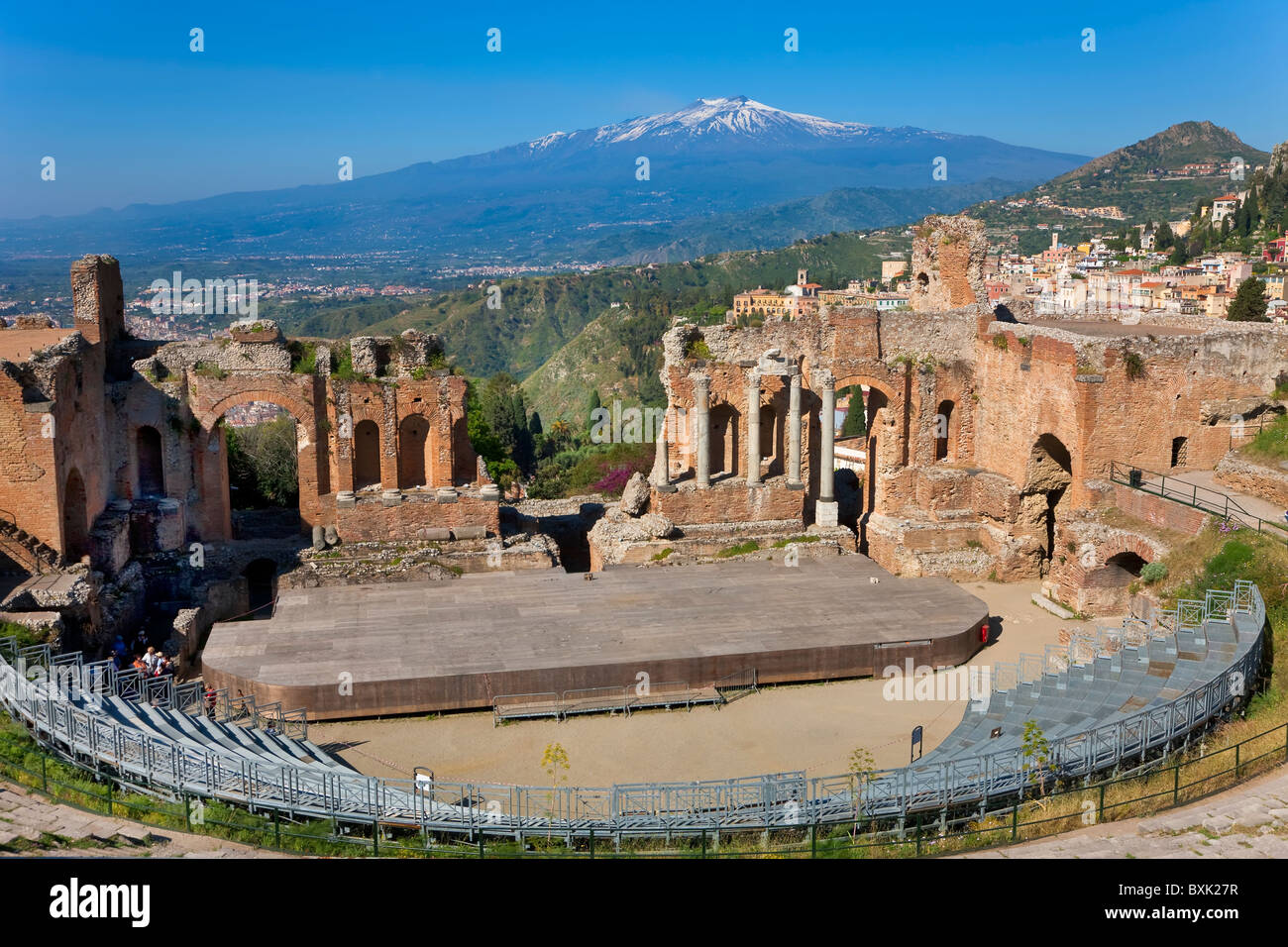 The Greek theatre and Mount Etna, Taormina, Sicily, Italy - Stock Image
