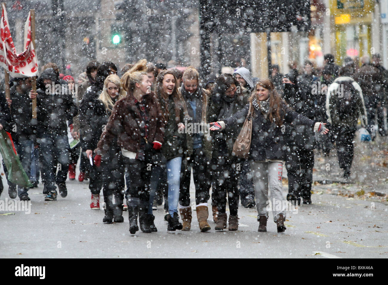English Students' anti cuts protest through the snowy streets of London. Stock Photo