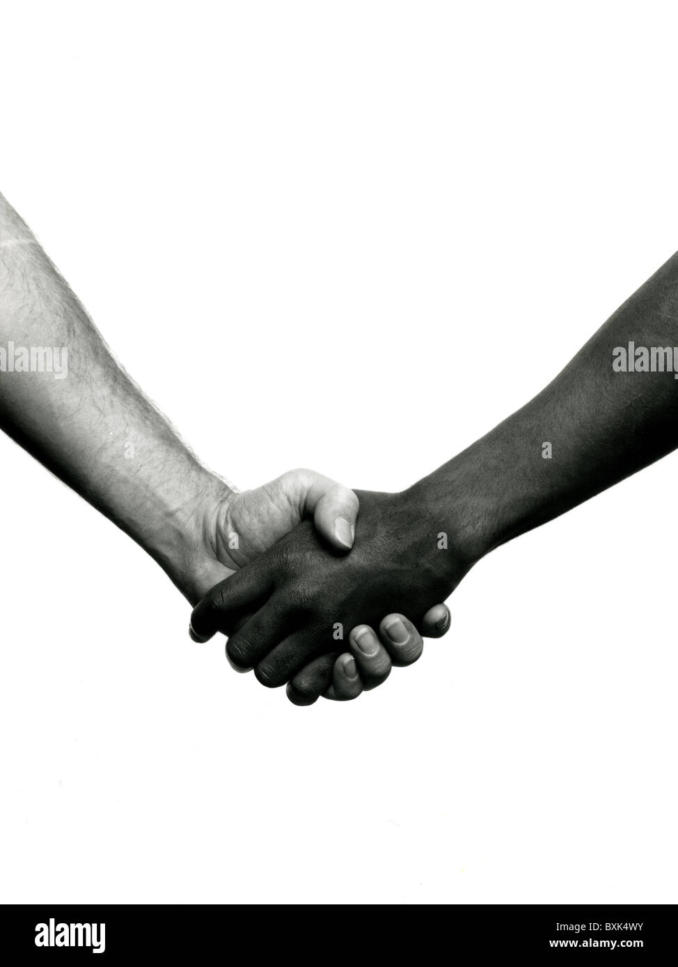 b&w picture of two men shaking, hands only; one man black and one man white; biracail handshake - Stock Image