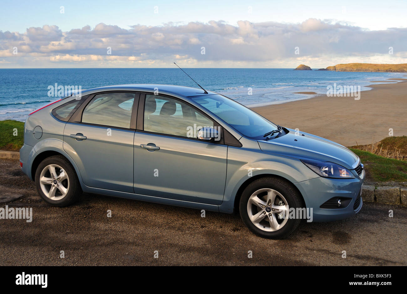 A Ford Focus Zetec 1.6 L parked overlooking the beach at Perranporth in Cornwall, UK - Stock Image
