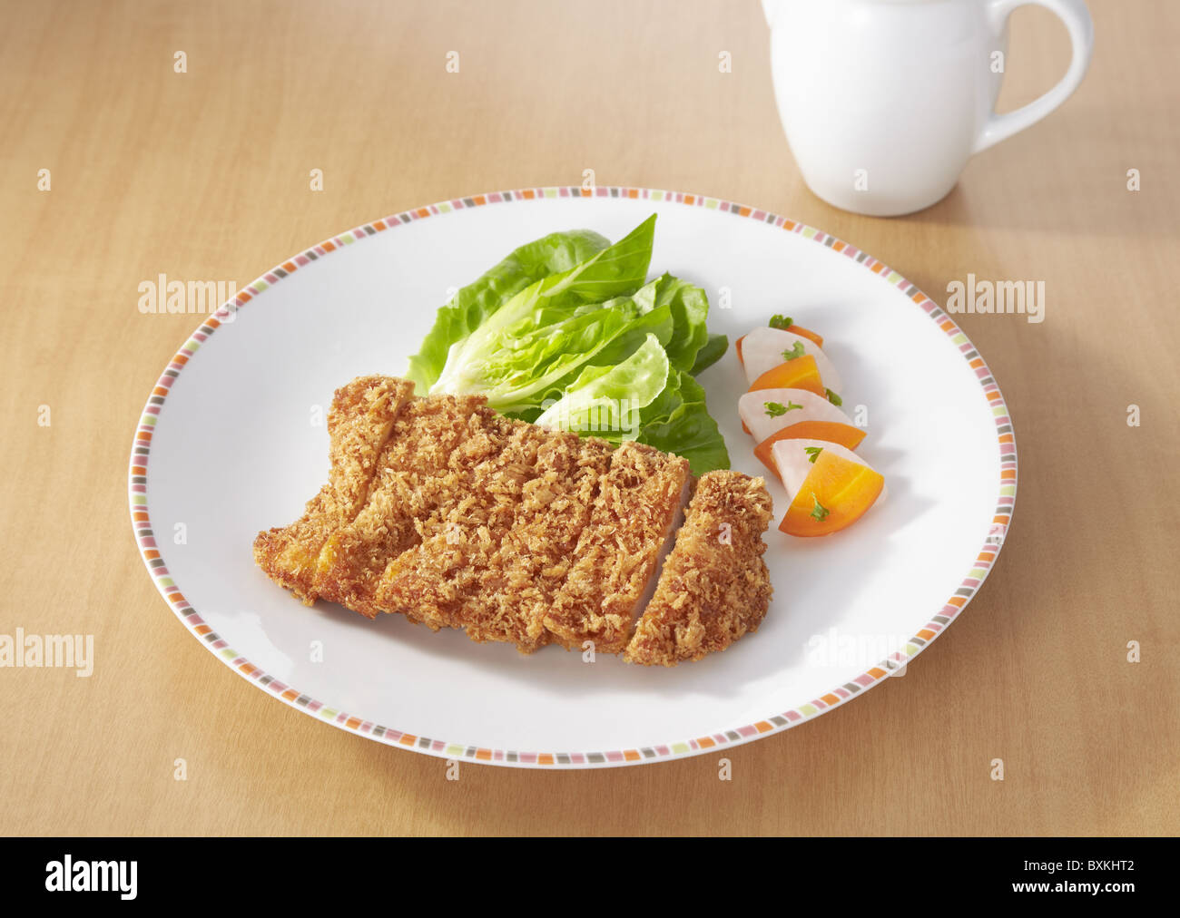 Deep fried chicken cutlet - Stock Image