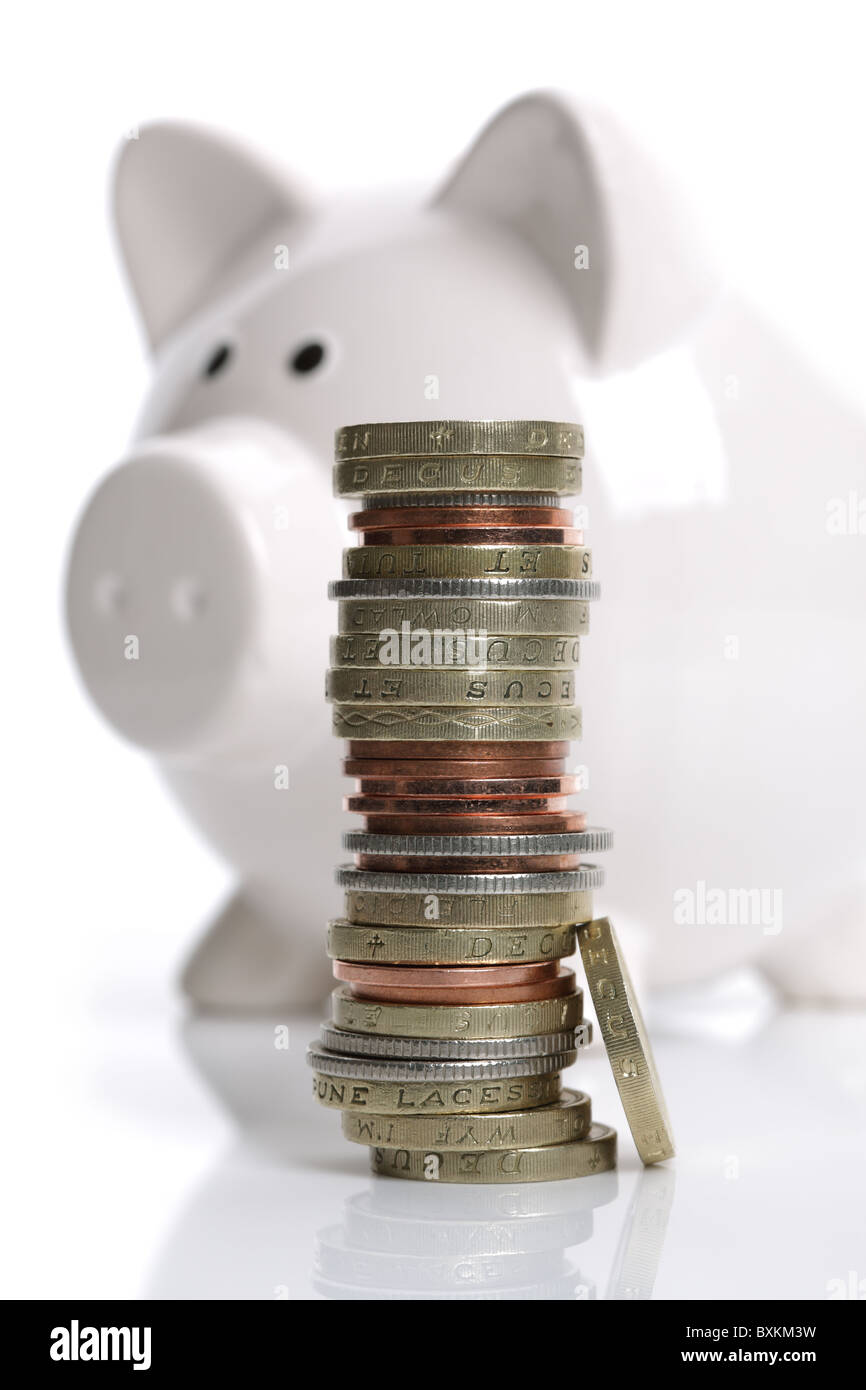 Piggy bank and coins - Stock Image