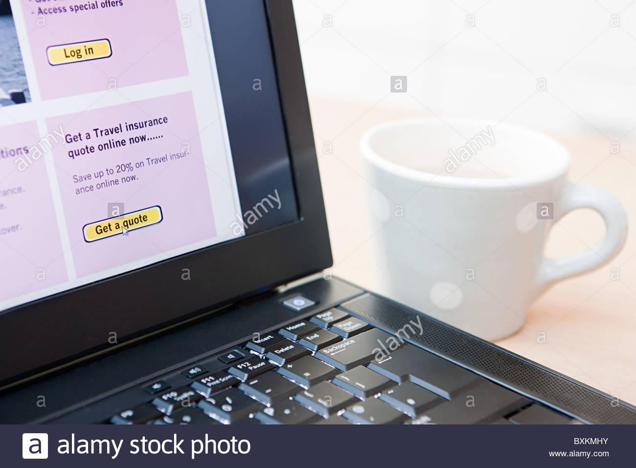 Travel insurance on laptop - Stock Image
