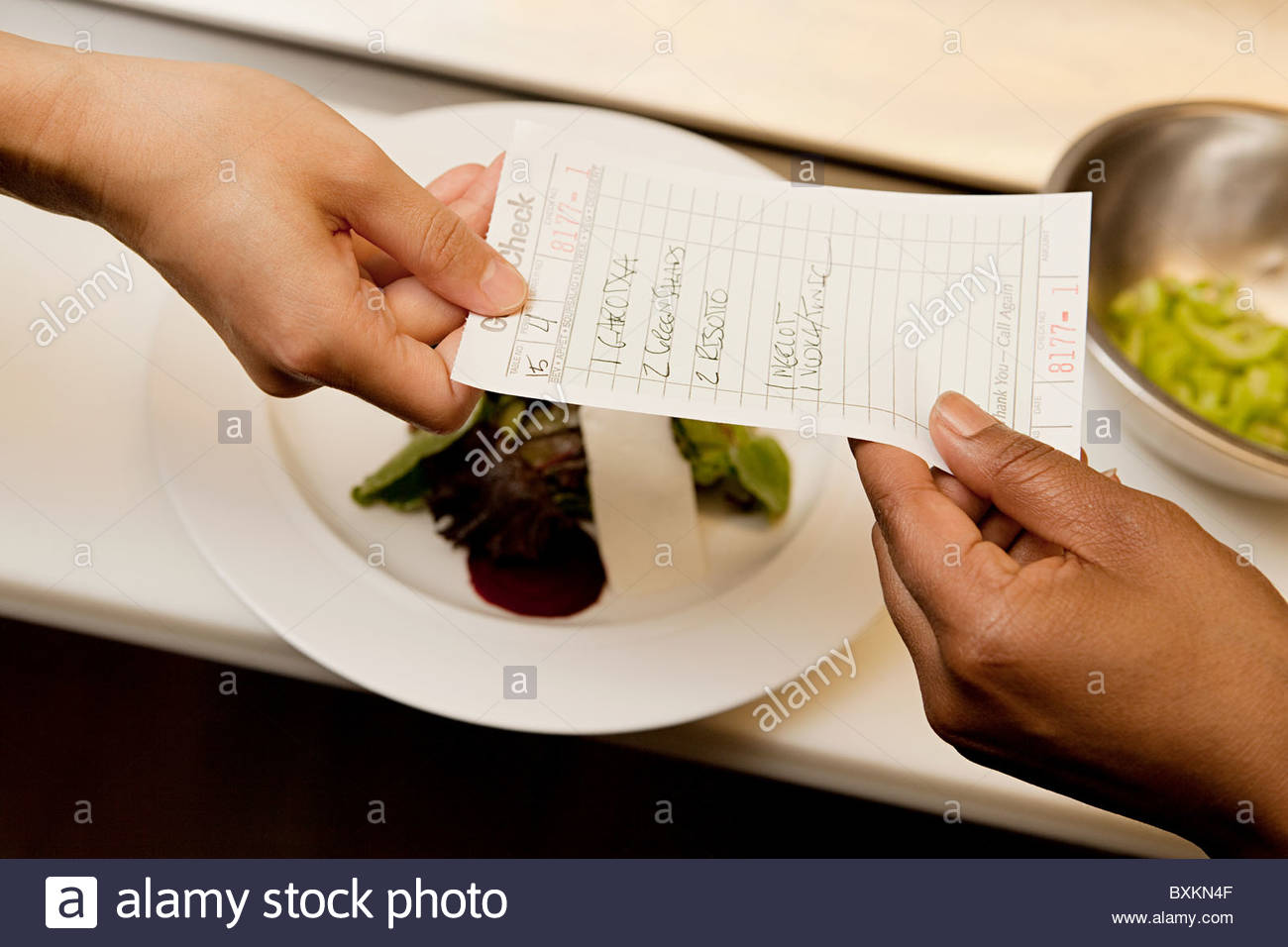 Food order being given to chef - Stock Image