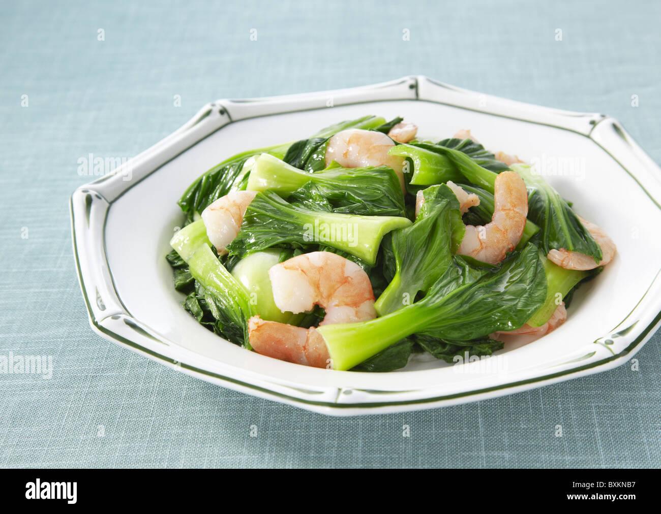 Stir fried shrimp and bok choy - Stock Image