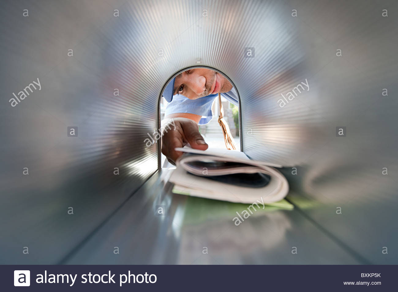 Man collecting mail from mailbox - Stock Image