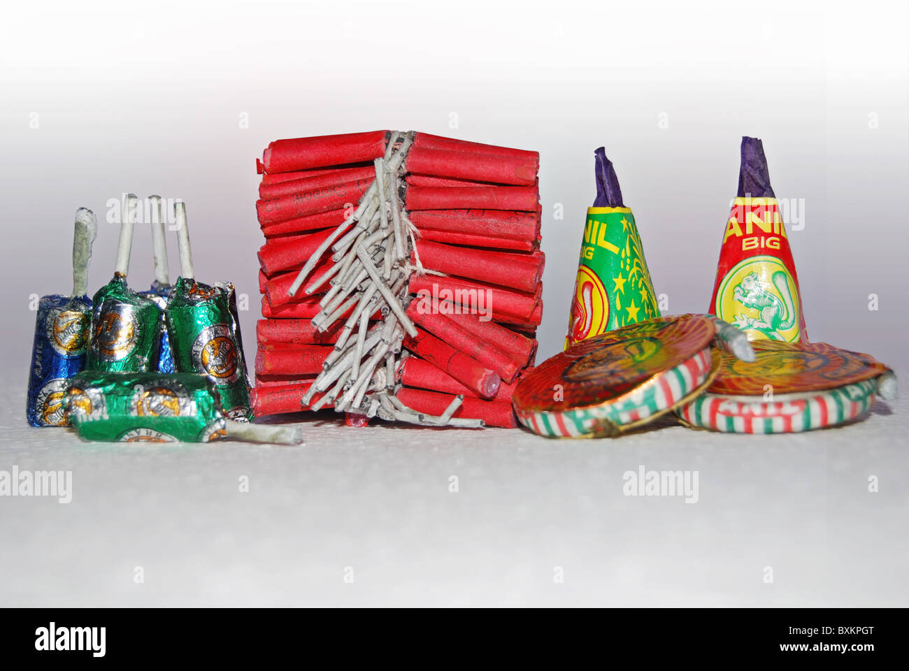 Variety of firecrackers- small bombs, flower pots, ground chakkars, red crackers. Firecrackers are essential part - Stock Image