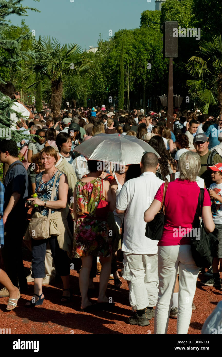 Crowd of Tourists, Visiting Paris, France, Garden Festival, Champs-Elysees on Street - Stock Image