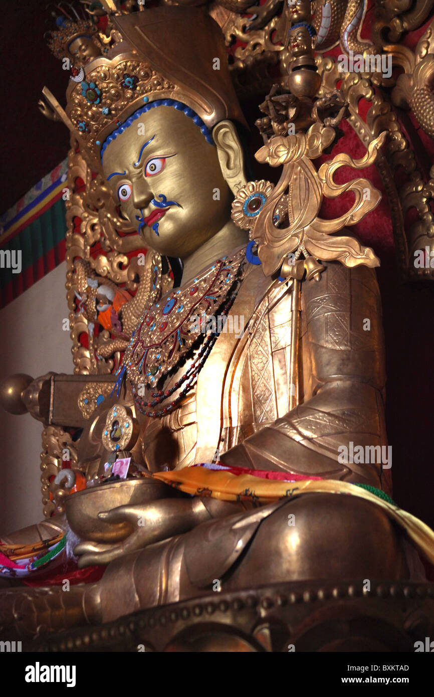 A Buddha image at Rongbuk Monastery, a Tibetan monastery in the Basum township close to Everest Base Camp, Tibet, - Stock Image