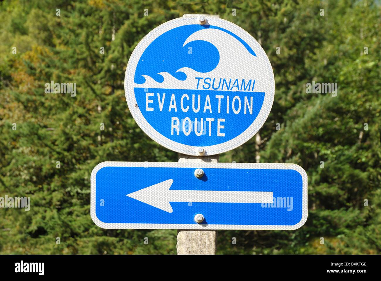 Tsunami Evacuation Route road sign with arrow -- Harbor Wave Stock Photo