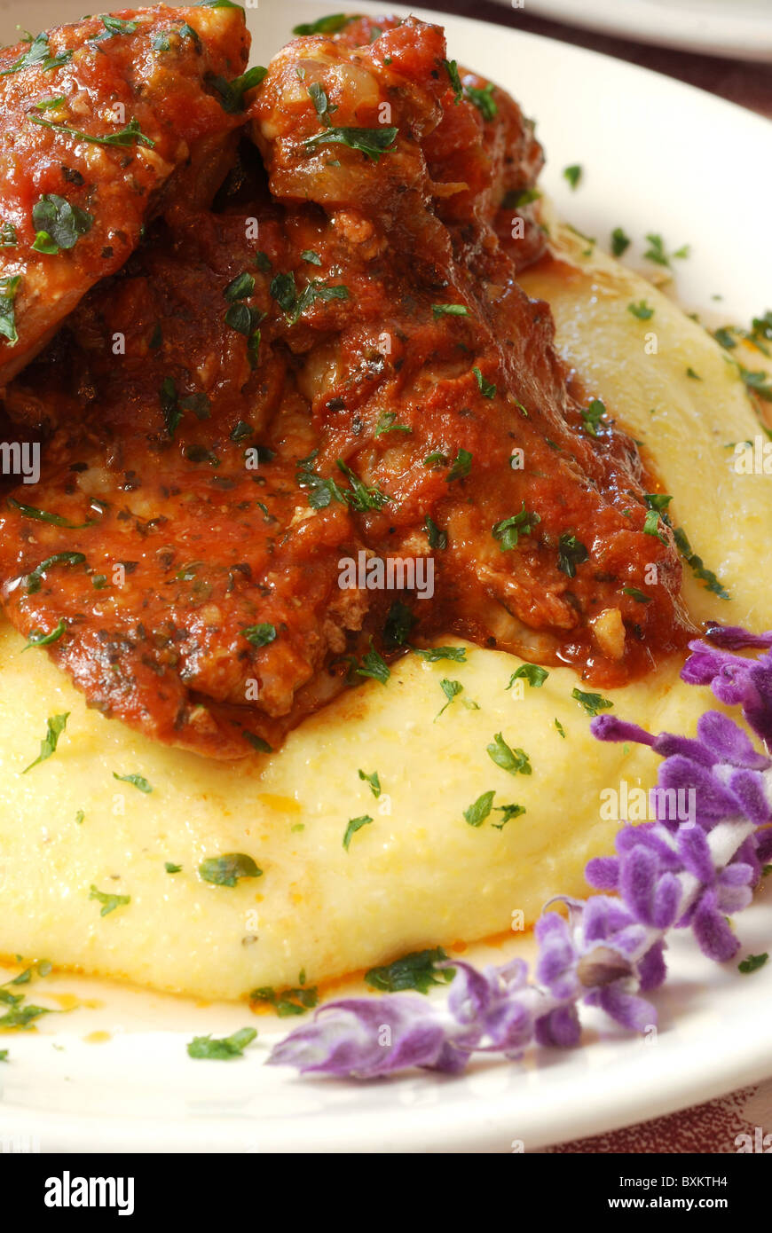 Chicken cacciatore on a bed of fresh polenta Stock Photo