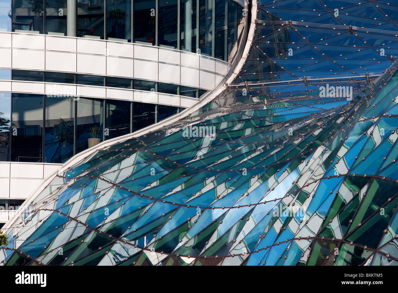 Abstract architecture of a modern contemporary building, reflections on a glass roof - Stock Image