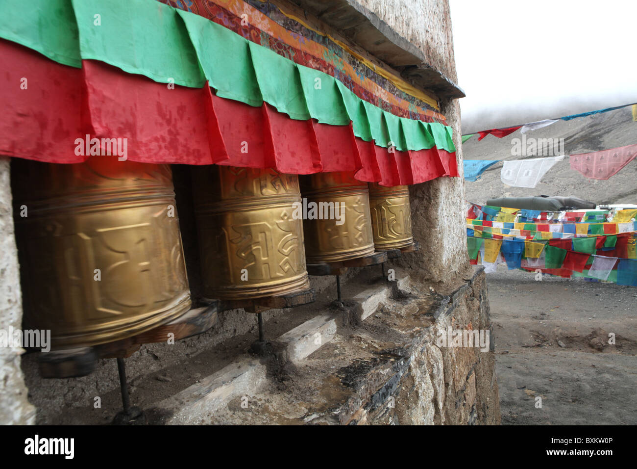 Prayer wheels at Rongbuk Monastery, a Tibetan Buddhist monastery in the Basum township close to Everest Base Camp, - Stock Image