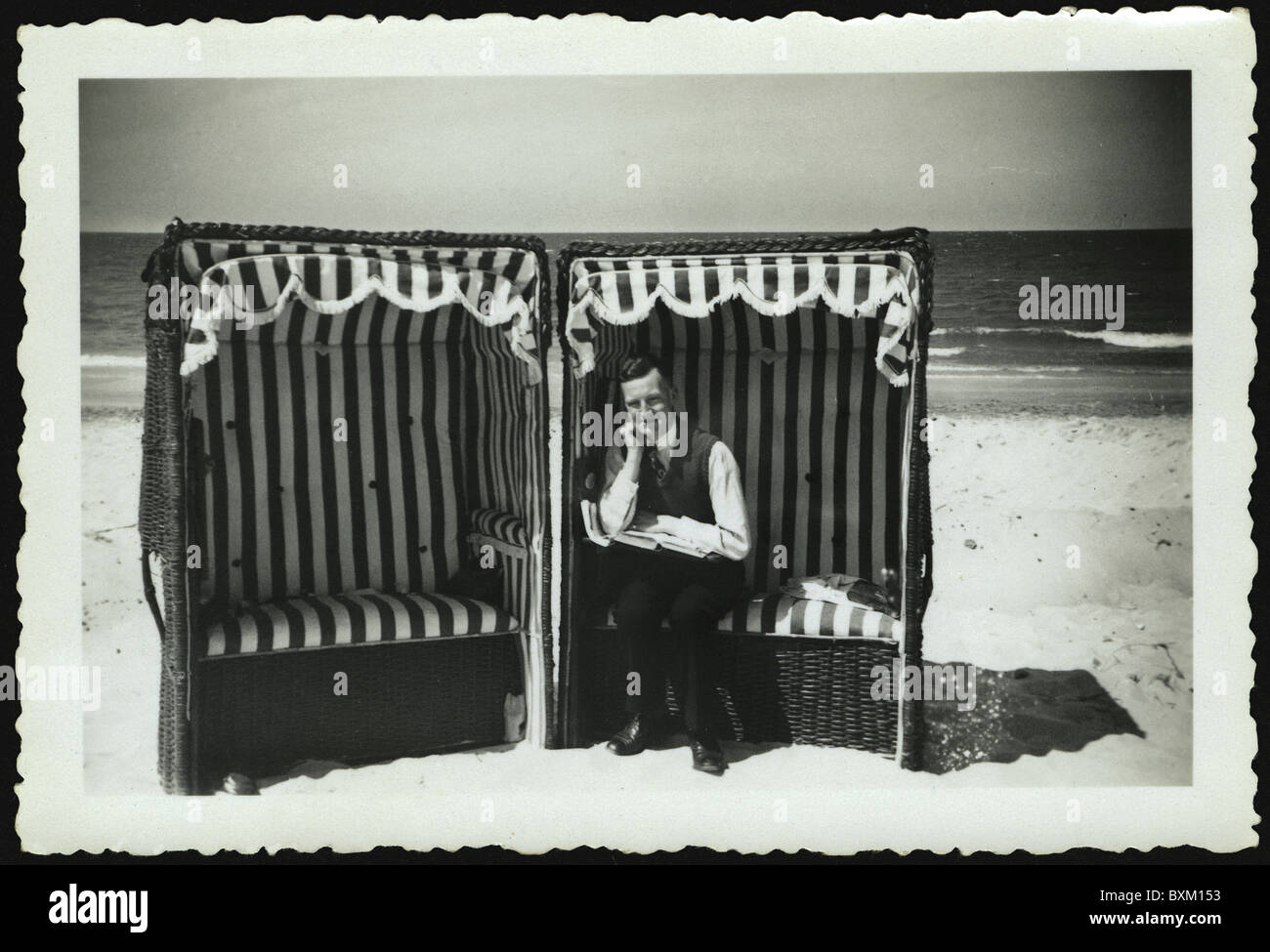 tourism, vacationer, bather sitting in beach chair, Baltic Sea, Misdroy, Poland, June 1935, Additional-Rights-Clearences - Stock Image