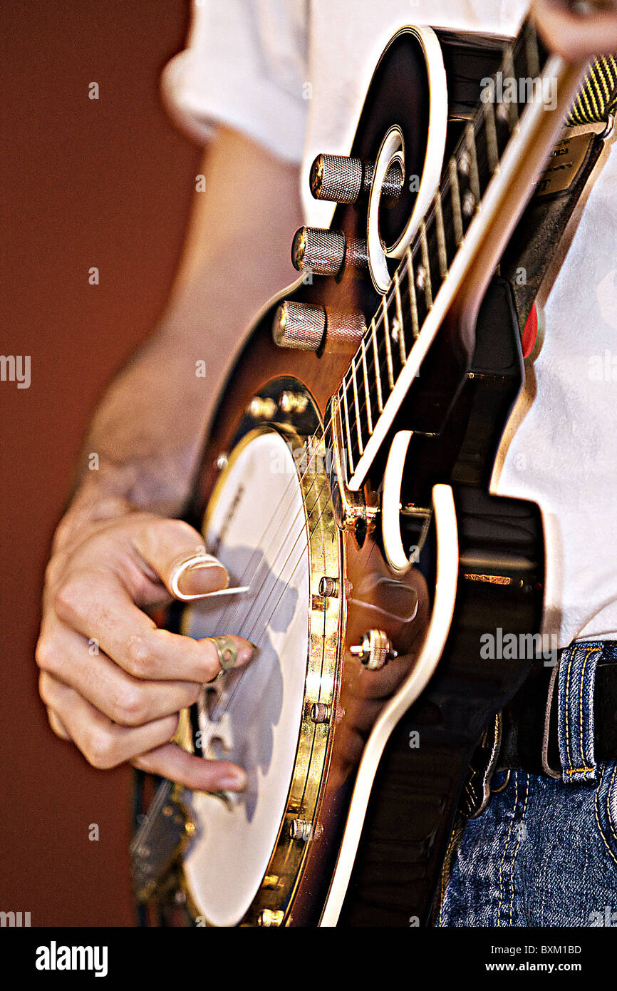 Mumford and Sons Banjo player - Stock Image