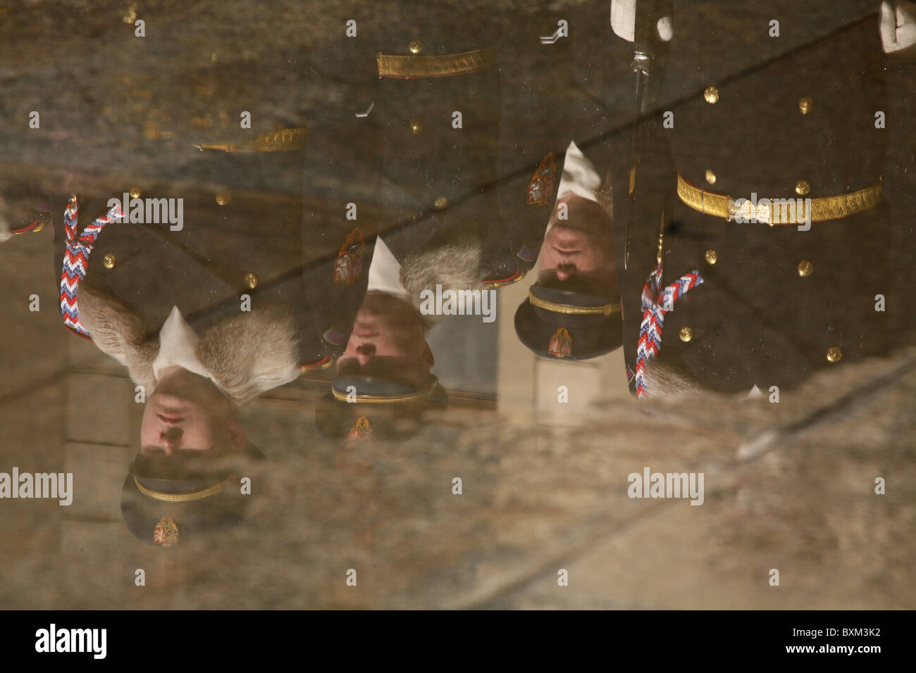 Reflection of the Presidential Guard of Honour in winter uniform at the Prague Castle in Prague, Czech Republic. - Stock Image