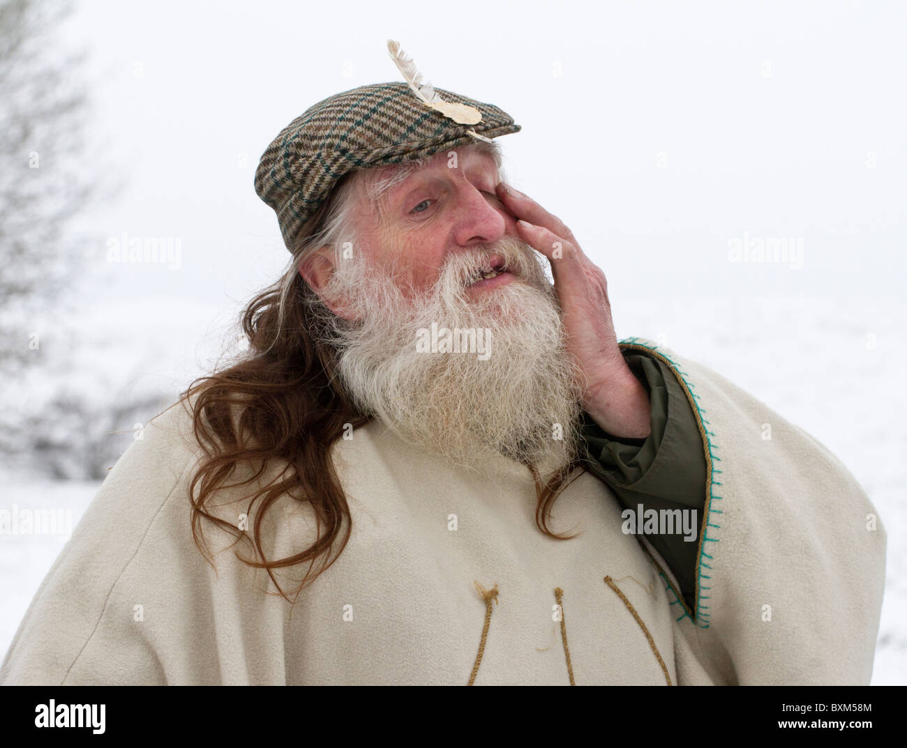 Arch-druid and Keeper of the Stones Terry Dobney celebrating the Winter Solstice at the Avebury stone circle in - Stock Image