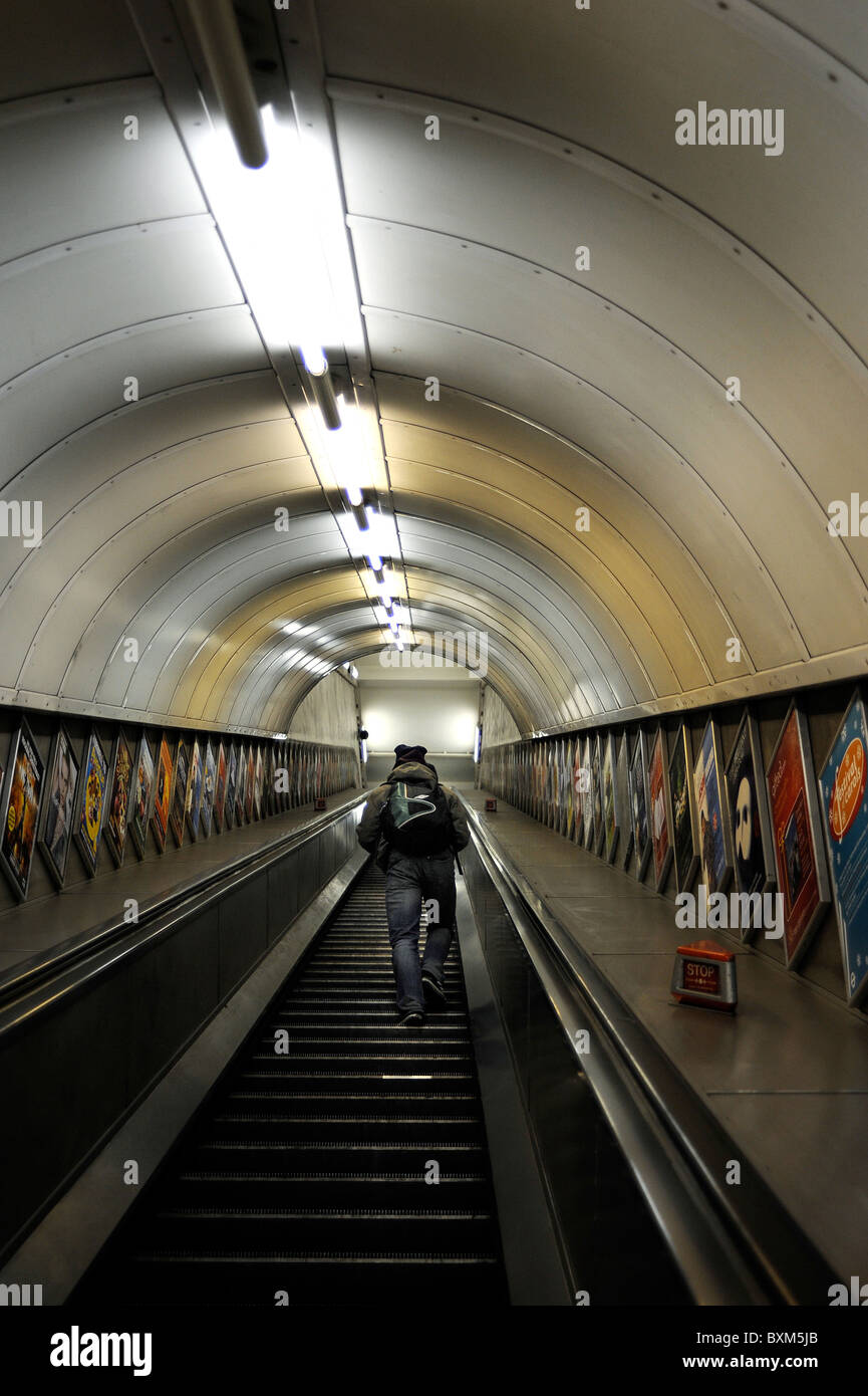Man going up the Escalator at Highgate Tube Station, North London - Stock Image