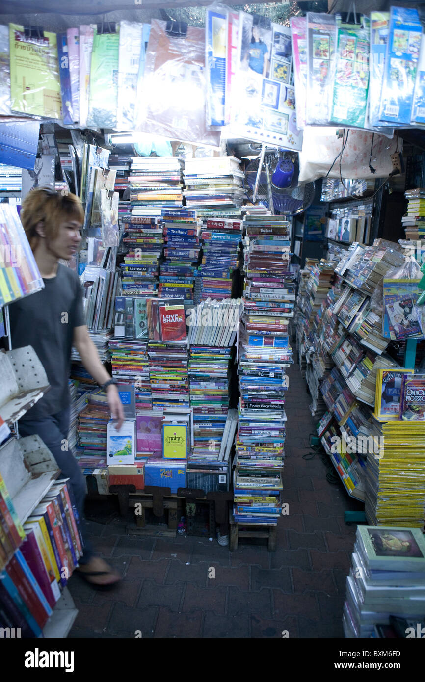 Books for sale including old Lonely Planet Guides at Chatuchak Weekend  Market - Stock Image