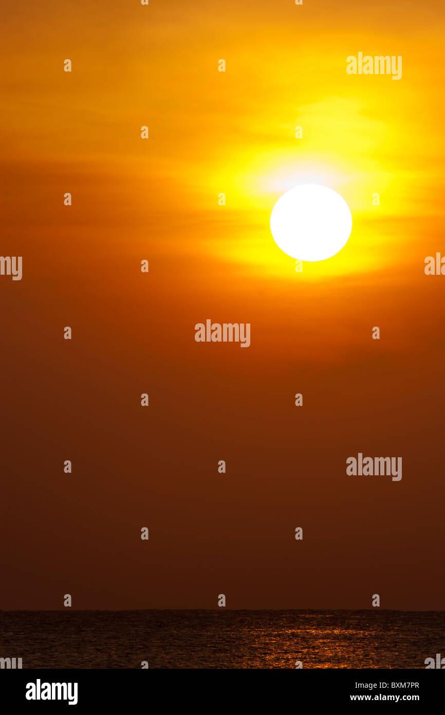 Golden Sunrise over the Indian Ocean at Nilaveli near Trincomalee on Sri Lanka's East Coast. - Stock Image