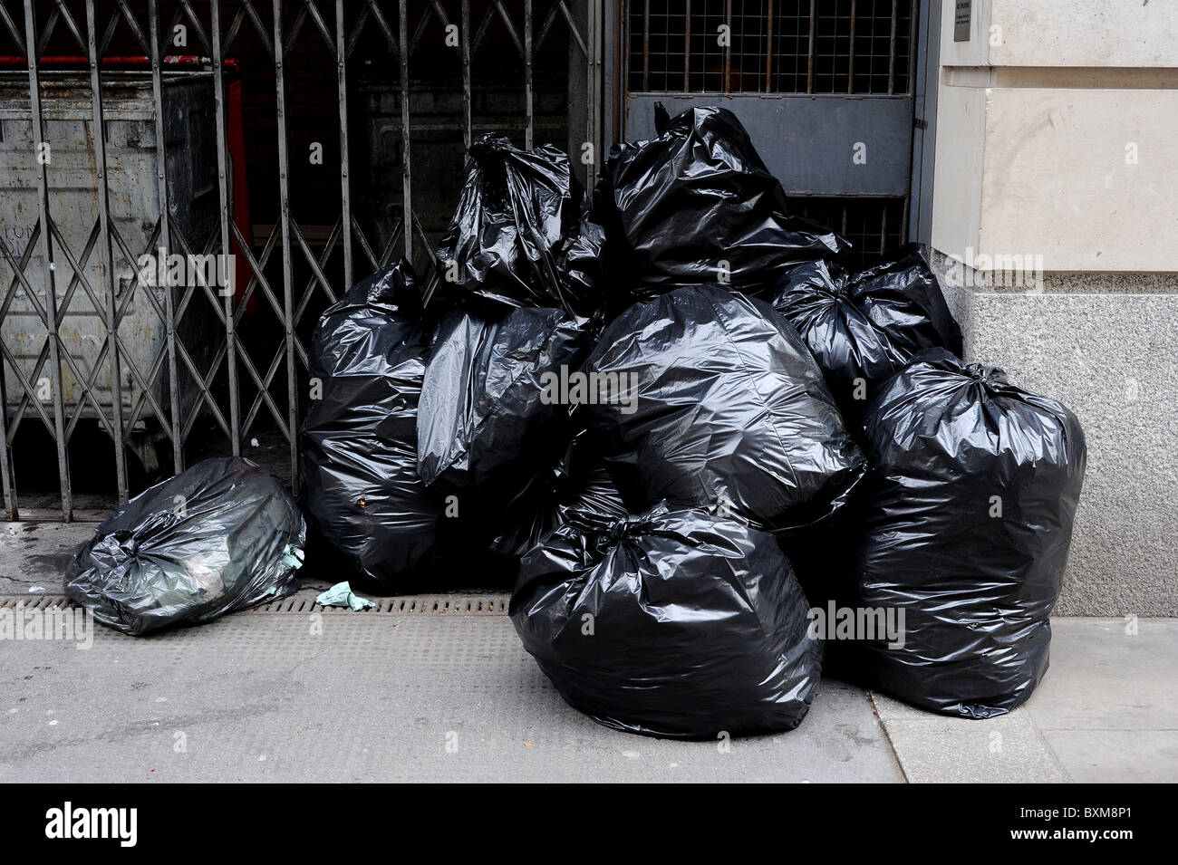 Rubbish bags in the street, Business District Central London - Stock Image