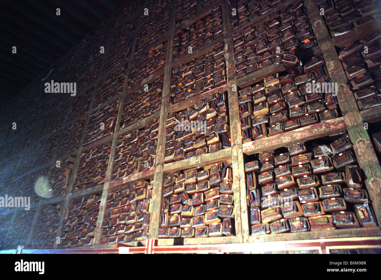 Religious scripts stacked high at The Sakya Monastery, a Buddhist monastry about 127km west of Shigatse in Tibet. - Stock Image