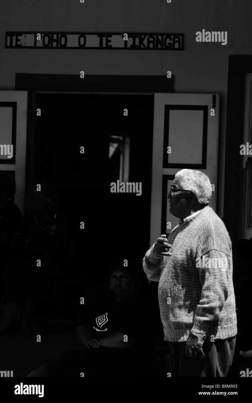 Maori elder speaking at family reunion ceremony in tokomaru bay marae,new zealand - Stock Image